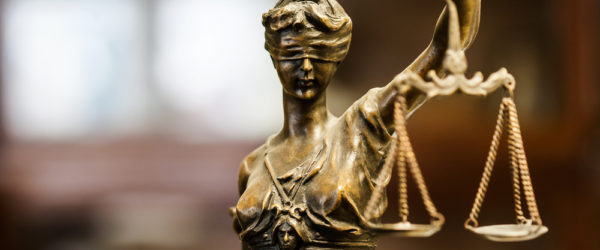 Scales of Justice: Legal Ramifications for Sign Language Interpreters